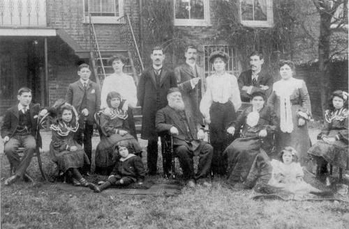 The grandparents of Oliver Sachs, Marcus and Chaya Landau, with their 13 children in the garden of their house in Highbury New Park (1902).